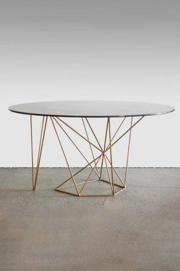 Acute dining table – a sur mesure geometric table